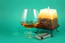 Glass Of Cognac And Burning Cand Royalty Free Stock Image
