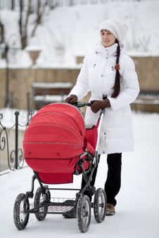 Free Woman With Baby Carriage Stock Photography - 8087842