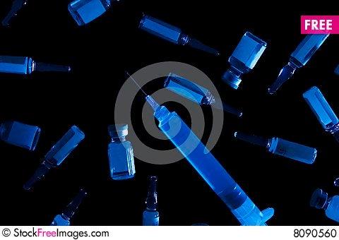 Vials, ampules and syringe Stock Photo