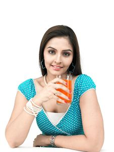 Free Woman Drinking Orange Juice Stock Images - 8091004