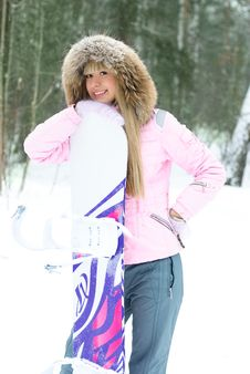 Young Woman With A Snowboard Royalty Free Stock Image