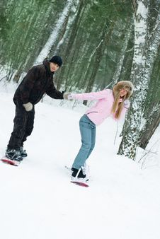 Free Young Couple Smowboarding On The Mountain Stock Photo - 8098480