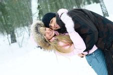 Happy Couple In Winter Park Royalty Free Stock Photos