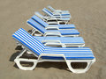 Free Nine Beach-chairs Stock Photography - 815242