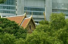 Buddhist Temple Among Trees In Bangkok Stock Photography