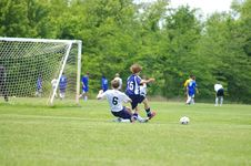 Free Soccer Slide Tackle Royalty Free Stock Photography - 815057