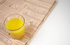 Free Glass Of Orange On Newspaper Stock Images - 817904