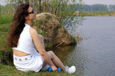 Free Fitness Girl Relaxing Near A Lake Royalty Free Stock Image - 819496