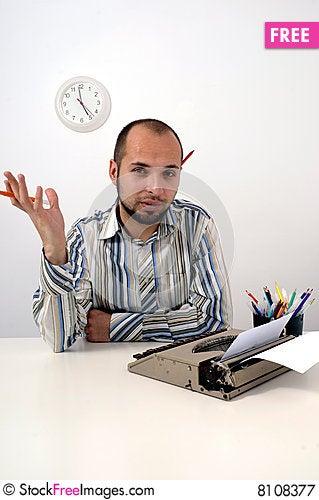 Free Man Typing On Old Typewriter Royalty Free Stock Photography - 8108377