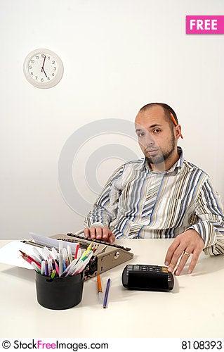 Free Man Typing On Old Typewriter Stock Photos - 8108393