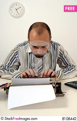 Free Man Typing On Old Typewriter Stock Photography - 8108442