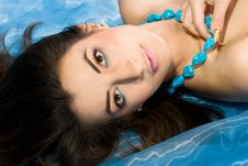 Woman With Blue Beads Royalty Free Stock Image