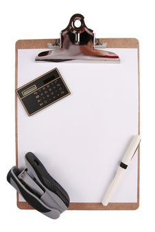Clipboard With Calculator, Pen And Stapler Royalty Free Stock Images