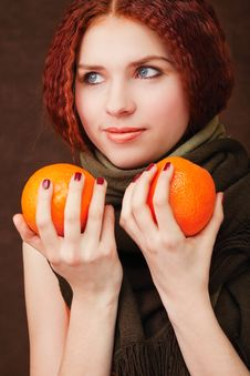 Free Young Pretty Girl With Two Oranges Stock Photo - 8102750