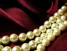 Pearls On Red Silk Stock Photos