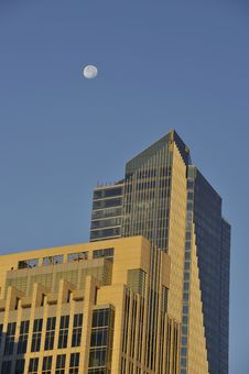 Moon Over Buildings Royalty Free Stock Photos