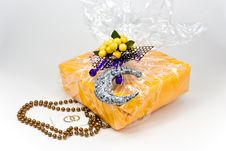 Gift Box With Pearls Decoration And Figurine Lemon Stock Image