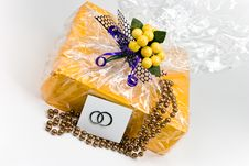 Gift Box With Pearls Decoration And Figurine Lemon Stock Photography