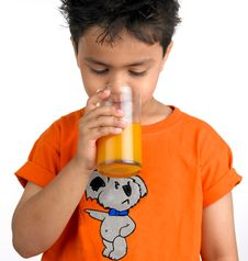 Free Indian Boy Drinking A Glass Of Juic Stock Images - 8106514