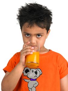 Free Boy Drinking A Glass Of Juic Royalty Free Stock Photo - 8106515