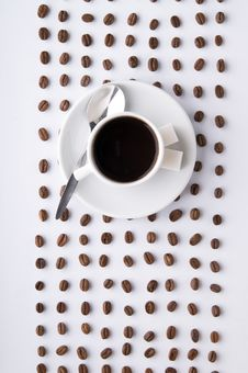 Free Coffee Cup And Lines Of Grains Royalty Free Stock Photography - 8106537