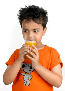 Boy Drinking A Glass Of Juice Royalty Free Stock Photos