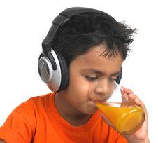 Free A Cute Boy Drinking Orange Juice Stock Photos - 8106553
