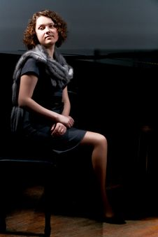 Free Pretty Young Lady Sitting Near Black Piano Stock Image - 8107701