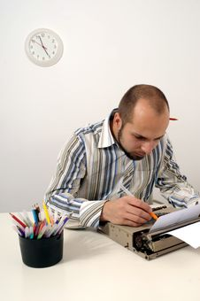 Man Typing On Old Typewriter Royalty Free Stock Images