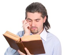 Free Young Guy Looks Into Book And Thinks Isolated Royalty Free Stock Photography - 8109617