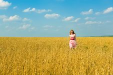 Free Happy Girl Walks Over The Field. Royalty Free Stock Photos - 8110918