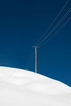 Free Power Pole And Wire On A Snowy Hill Royalty Free Stock Image - 8111156