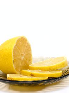 Lemon Slices On Plate Stock Photo