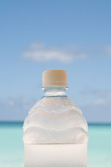Free Cold Bottle Of Water On Beach Royalty Free Stock Photos - 8113128