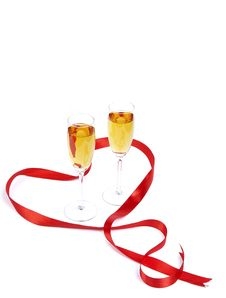 Free Two Wine Glasses And Red Satiny Tape Stock Photo - 8113200