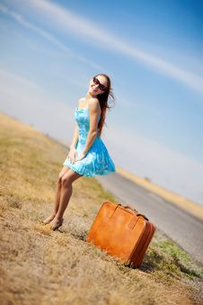 Free Girl And Suitcase Royalty Free Stock Image - 8113556