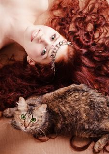 Free Young Girl Lying With A Cat Stock Images - 8116384