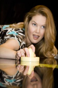 Free Young Woman Holding Air Hockey Mallet Stock Image - 8117121
