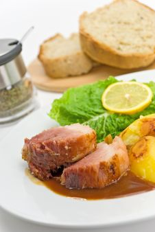 Free Roasted Slices Of Pork With Lettuce And Fried Pota Stock Image - 8118521