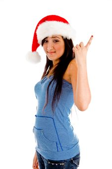 Free Pointing Girl With Christmas Hat Stock Photo - 8118550