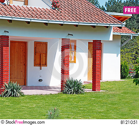 Free Small House And Lawn Stock Image - 8121051