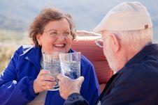 Free Happy Senior Adult Couple With Drinks Stock Photos - 8120573
