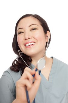 Happy Nurse Doing A Checkup Royalty Free Stock Photography