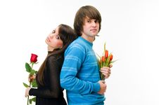 Young Couple With Rose And Tulips Stock Photo