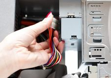 Free Woman Hand Assembles Computer Cable Stock Photos - 8123123