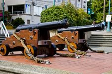Free Two Old Cannons On Sidewalk Royalty Free Stock Images - 8124649