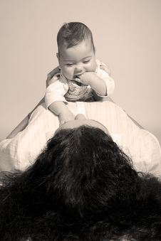 Baby On Top Of Mom Royalty Free Stock Photo