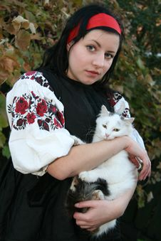 Village Girl With A Cat Royalty Free Stock Image