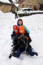 Free Kids Tobogganing In The Snow Royalty Free Stock Image - 8137166
