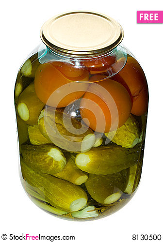 Big jar with cucumbers and tomatoes Stock Photo